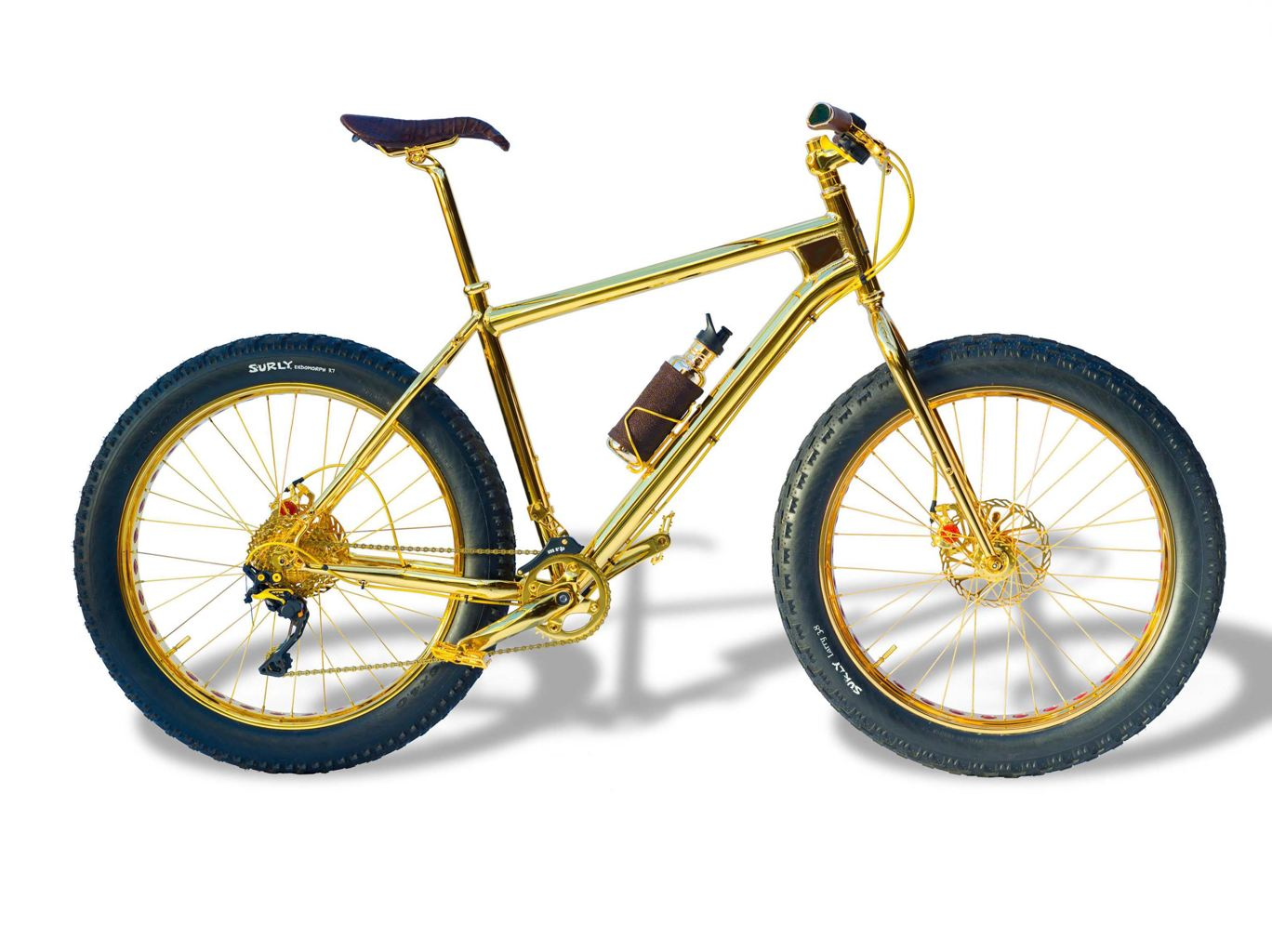 3ef25620-cb9d-11e3-8c33-07445b2e2595_solid_gold_bike_01.jpg